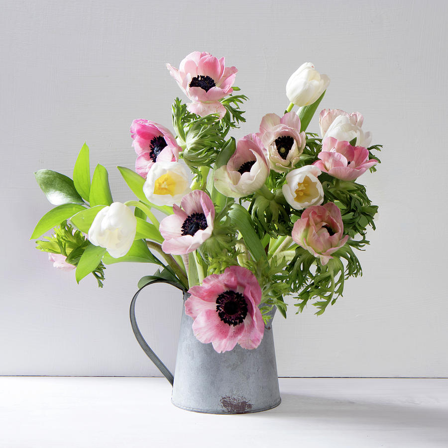 The wedding bouquet of anemones and tulips with ruscus in a jug on a anemone photograph the wedding bouquet of anemones and tulips with ruscus in a jug on izmirmasajfo