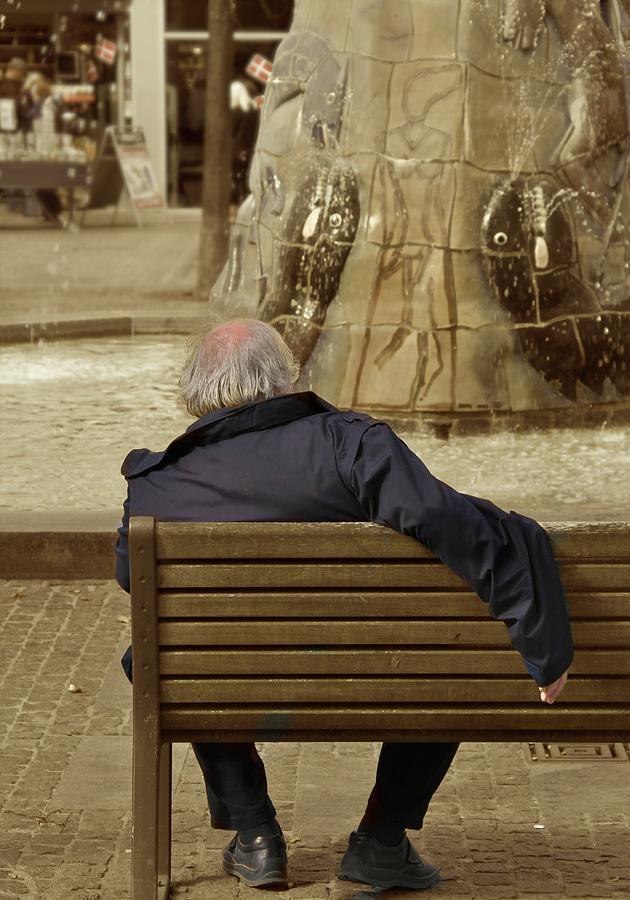 Street Scene Photograph - The World Turns by Odd Jeppesen