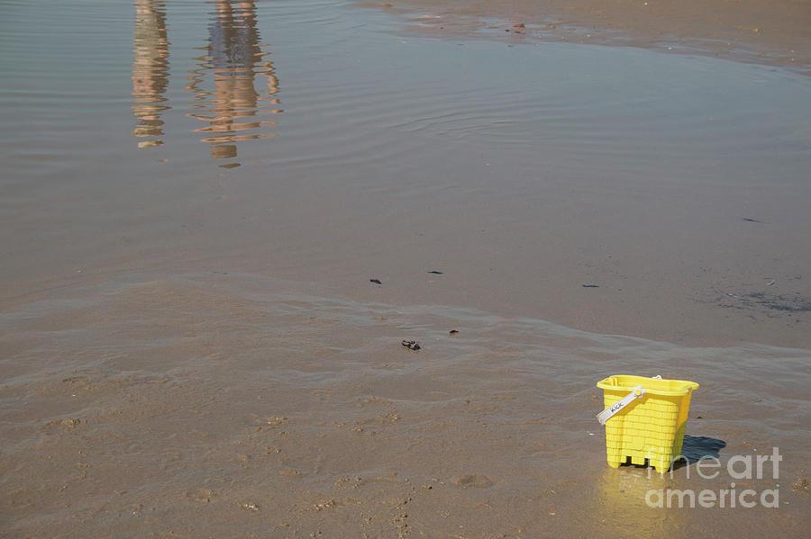 The yellow bucket by Ana Mireles