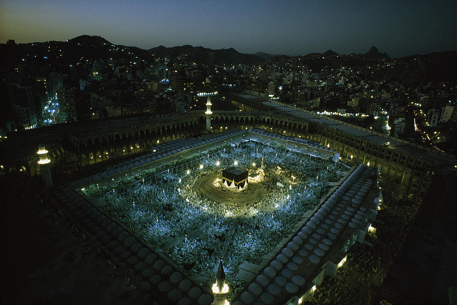 Color Image Photograph - Thousands Of Pilgrims Circle The Kaaba by Thomas J. Abercrombie