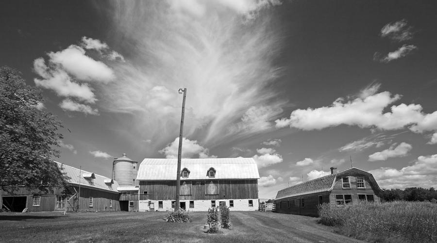 Black And White Photograph - Three Barns With Clouds On Clark Lakes Road by Stephen Mack