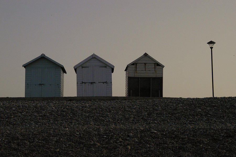 Beach Photograph - Three Beach Huts And A Lamp by Andy Thompson