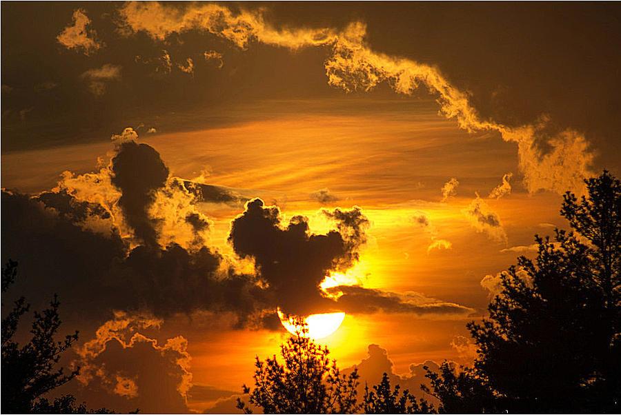 Thunder Mets Sunset Photograph by Kenneth Bourassa