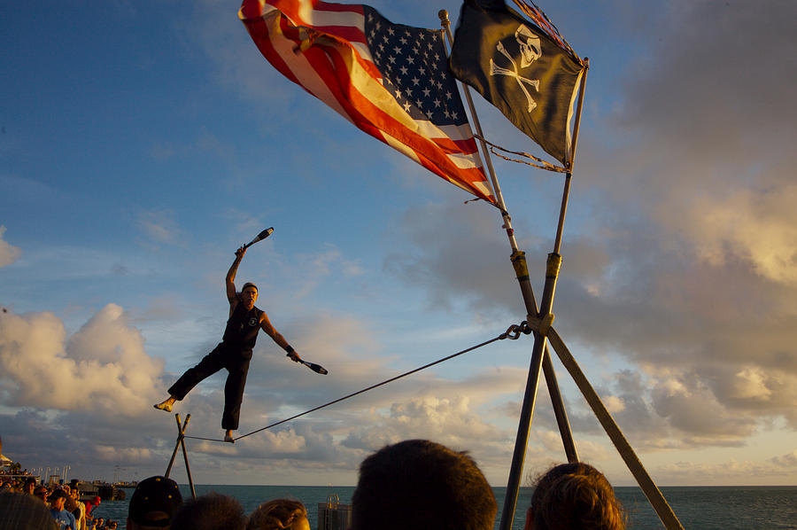 Balance Photograph - Tight Rope Walker In Key West by Carl Purcell