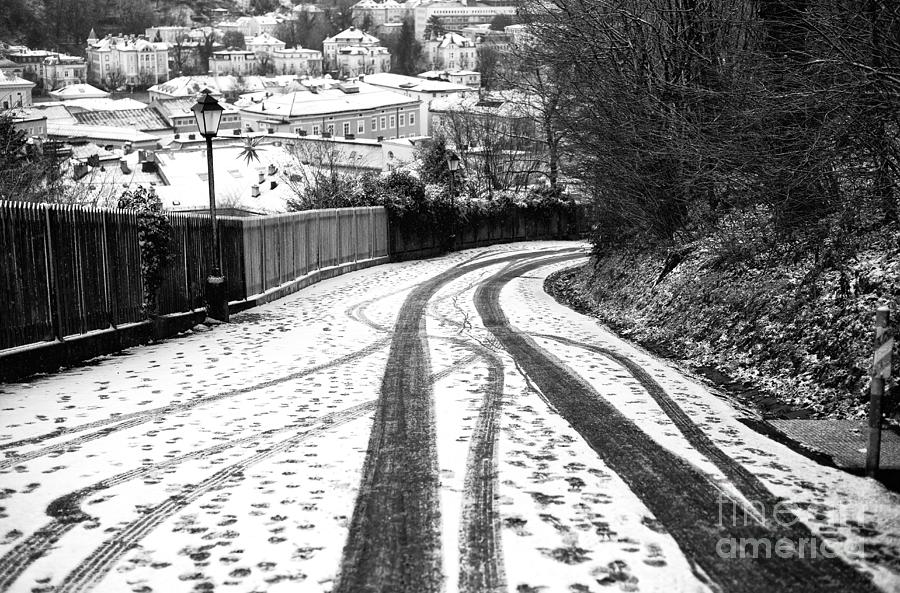 Street Photograph - Salzburg Tire Tracks In The Snow by John Rizzuto
