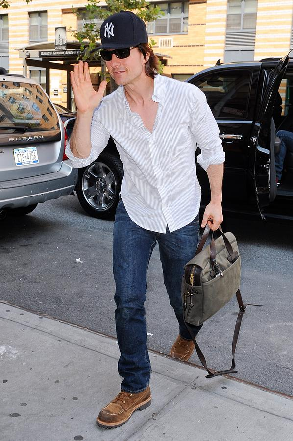 Tom Cruise Photograph - Tom Cruise Carrying A Filson Bag by Everett