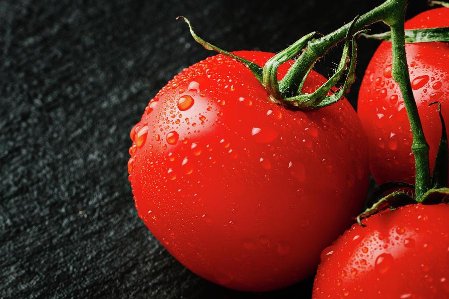 Background Photograph - Tomatoes Close Up On Black Slate by Tatiana Frank