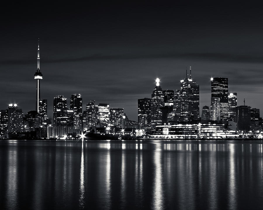 Brian Carson Photograph - Toronto Skyline At Night From Polson St No 2 Black and White Ver by Brian Carson