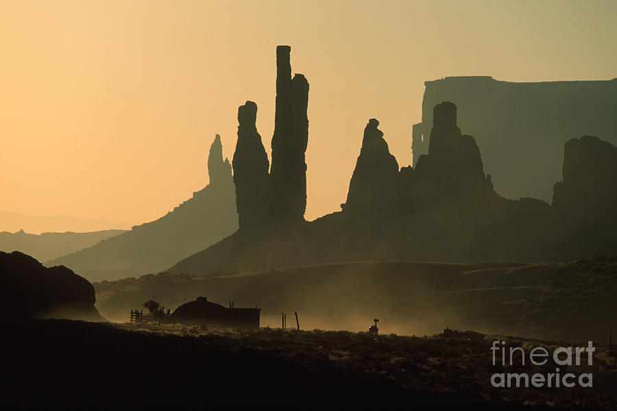 Monument Valley Photograph - Totems At Sunrise by Stan and Anne Foster