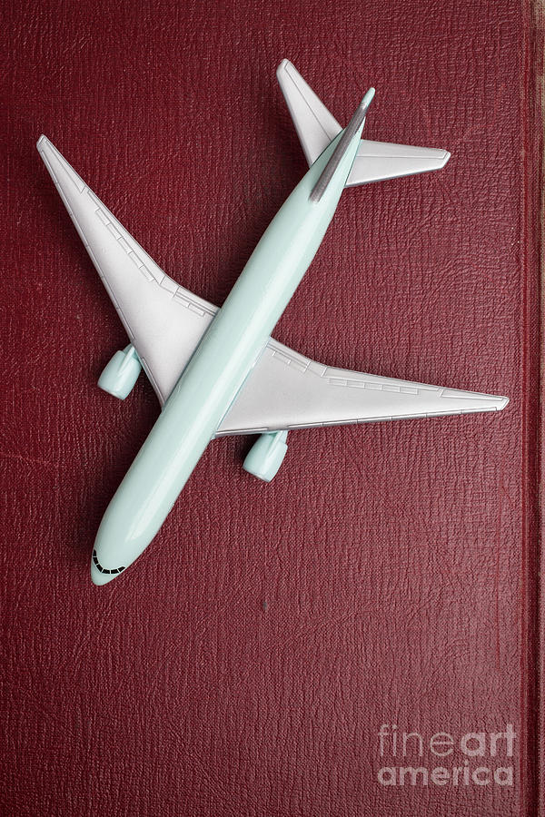 Still Life Photograph - Toy Airplane Over Red Book Cover by Edward Fielding