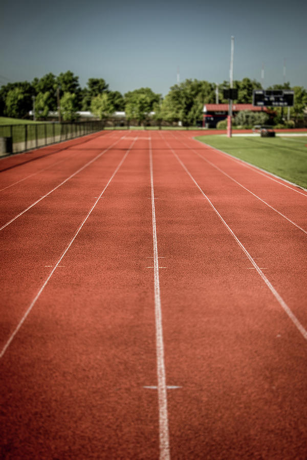 Track And Field Of Depth One Photograph by Howard Roberts