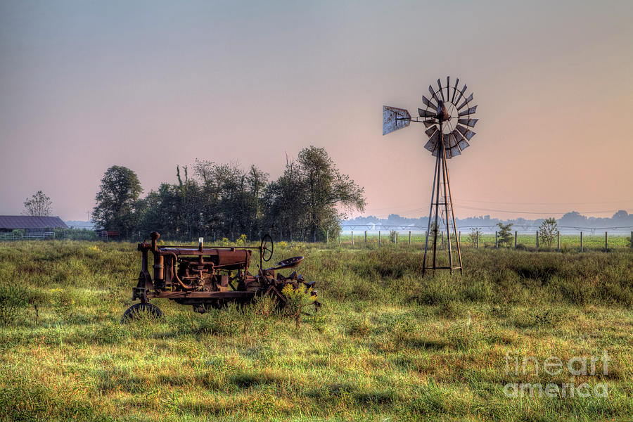 Driving Photograph - Tractor By A Windmill by Larry Braun