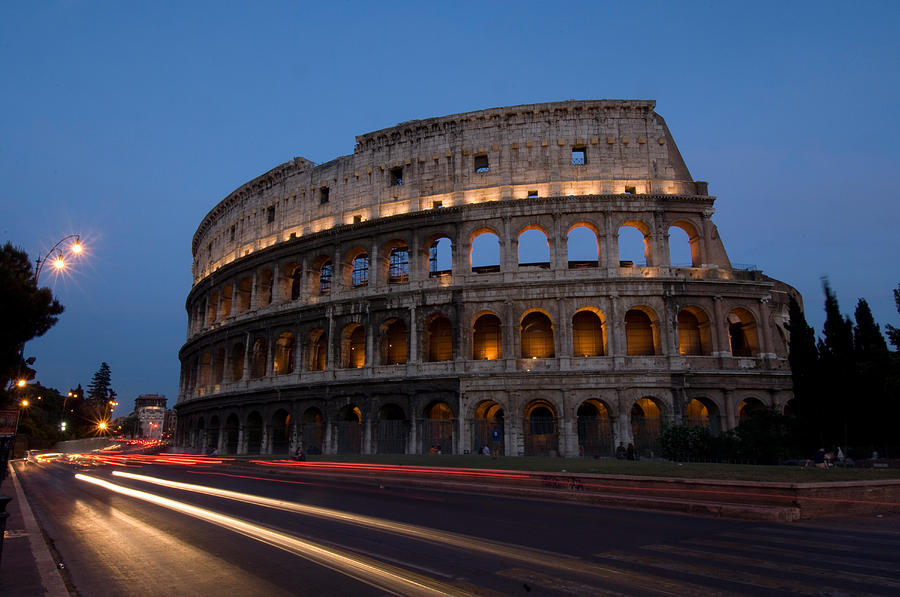 Photography Photograph - Traffic Goes By The Colosseum At Night by Joel Sartore