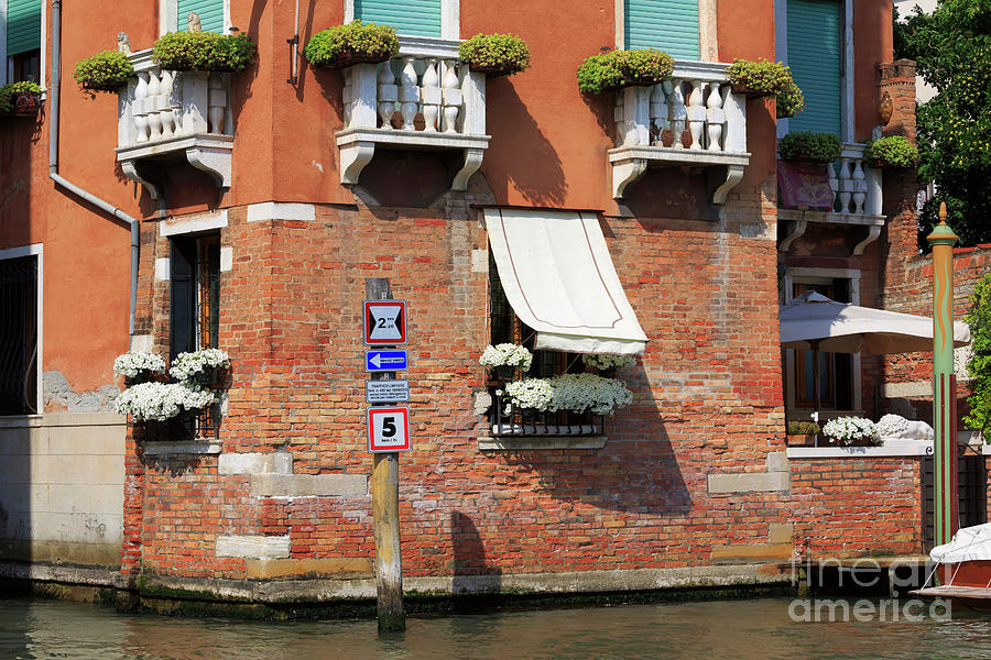 Traffic Signs Photograph - Traffic Signs On The Canal In Venice Italy by Louise Heusinkveld