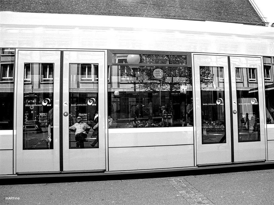 Tram Reflections In Black And White Photograph