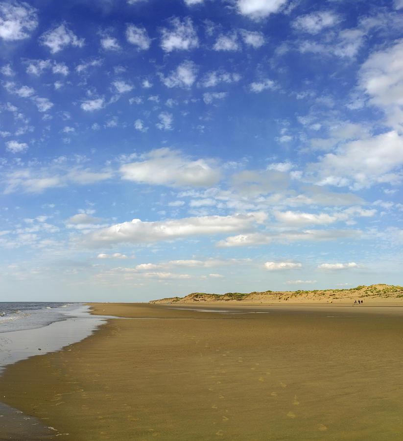 Cumulus Clouds Photograph - Tranquil Seashore by Gillian Dernie