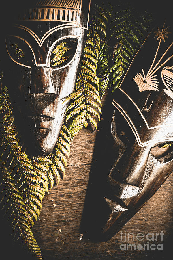 Tribal Masks With Ferns On Wooden Table by Jorgo Photography - Wall Art Gallery