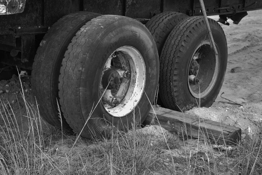 Black And White Photograph - Truck Tires by Rob Hans