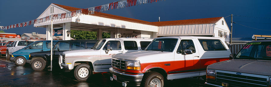 Color Image Photograph - Trucks In Used Car Lot, St. George, Utah by Panoramic Images