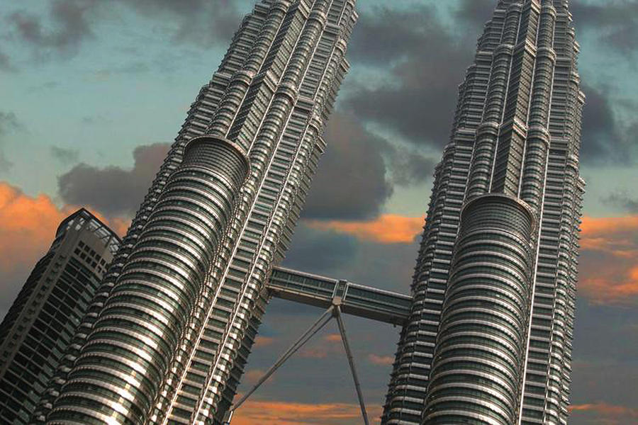 Petronas Twin Towers Photograph - Twin Towers by Debbie McIntyre