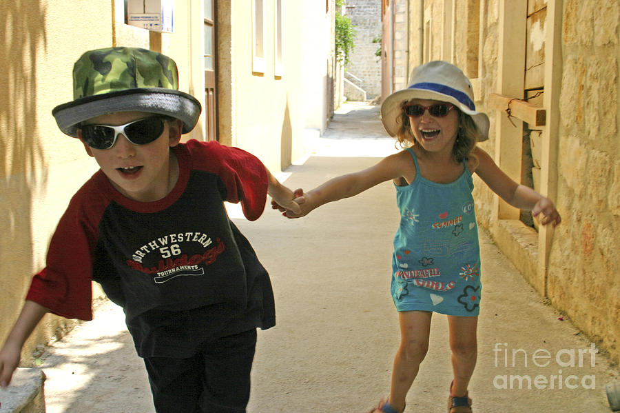 Child Photograph - Two Excited Children by Danny Yanai