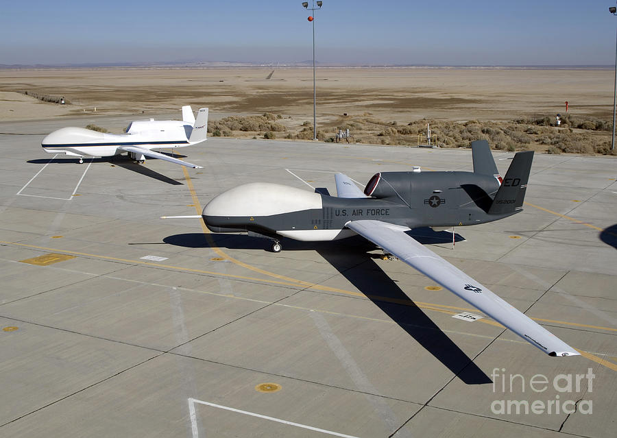 Global Hawk Photograph - Two Global Hawks Parked On A Ramp by Stocktrek Images