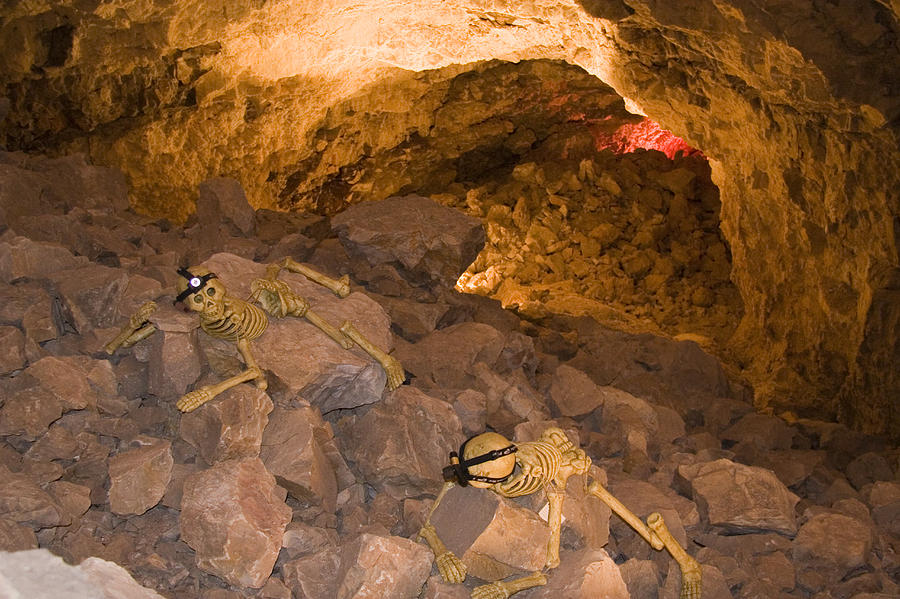 Spelunking Photograph - Two Skeletons Crawl Up A Rocky Hill by Taylor S. Kennedy