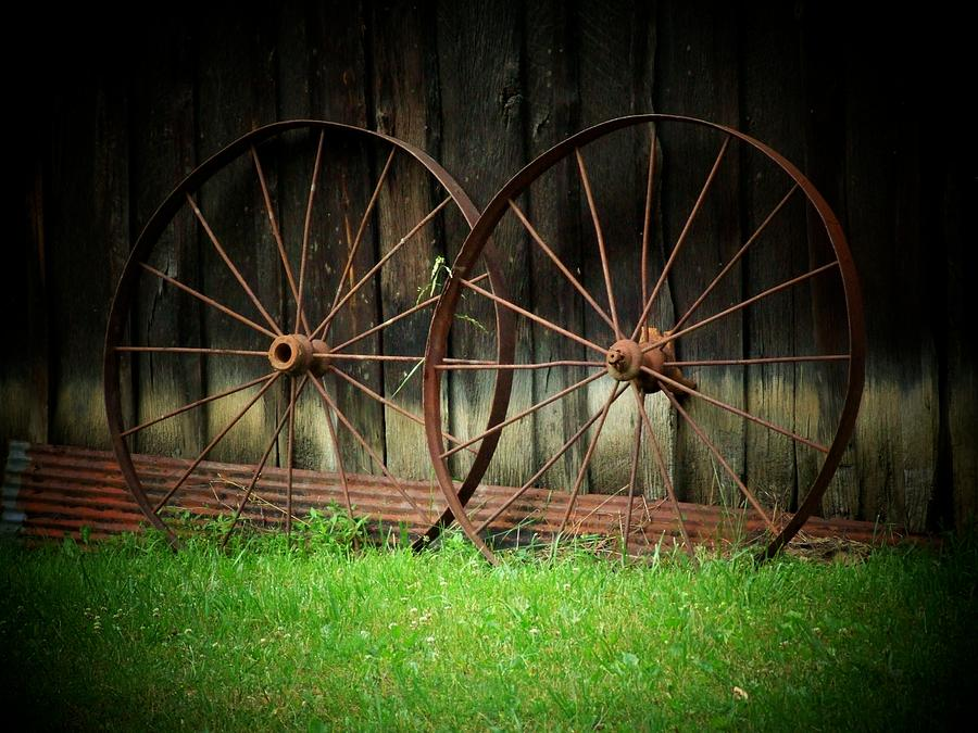 Wagon Wheels Photograph - Two Wagon Wheels by Michael L Kimble