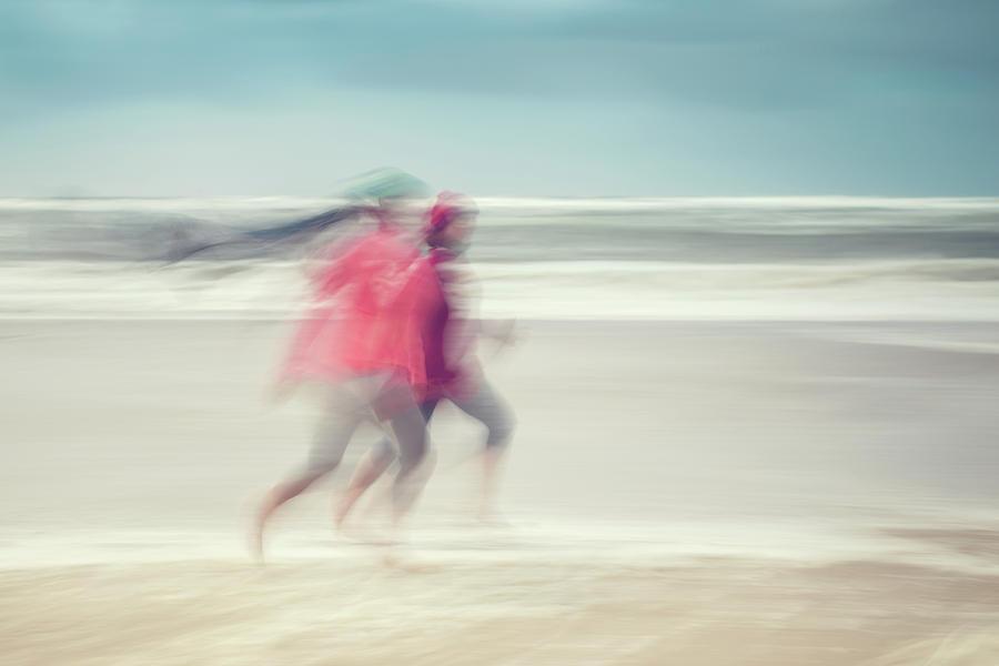 Beach Photograph - two women on beach No. 7 by Holger Nimtz