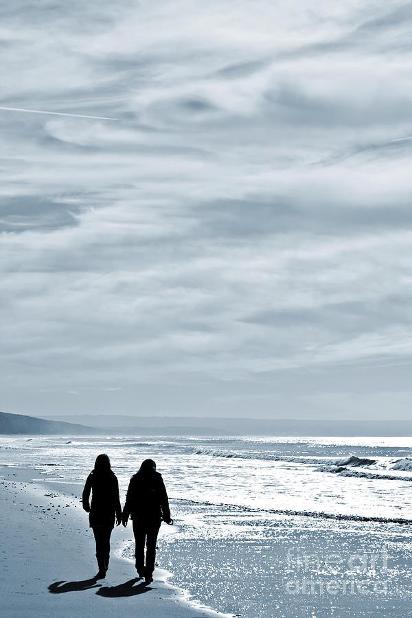 Women Photograph - Two Women Walking At The Beach In The Winter by Jose Elias - Sofia Pereira