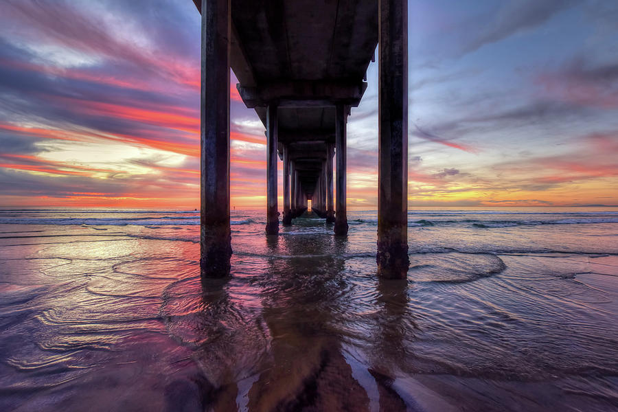 Under the Pier Sunset by Mark Whitt
