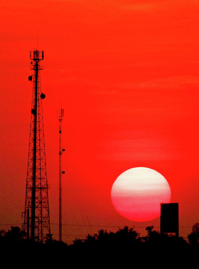 Vertical Photograph - Urban Sunset And Radiostation Tower Silhouettes by Rosita So Image
