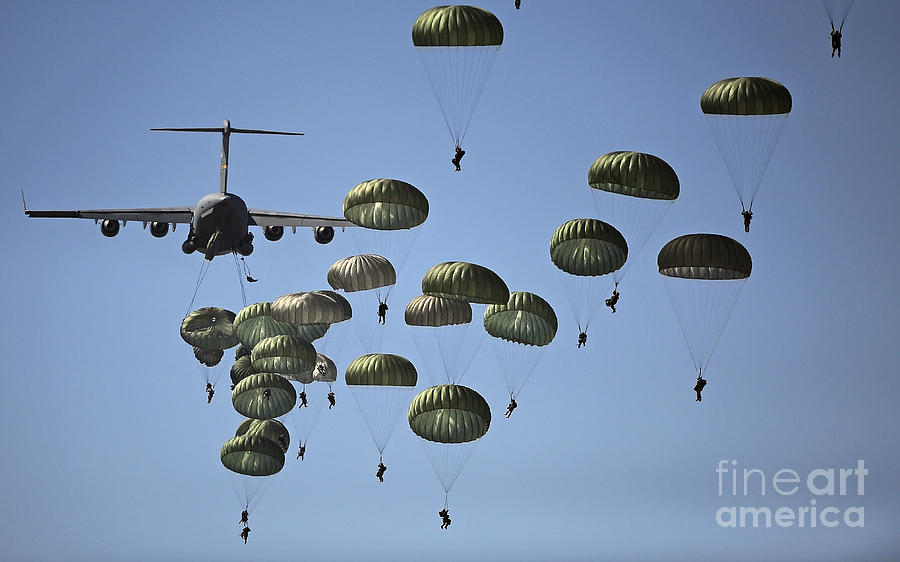 Paratrooper Photograph - U.s. Army Paratroopers Jumping by Stocktrek Images