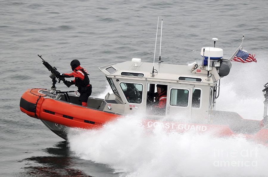 Patrol Photograph - U.s. Coast Guardsmen Aboard A Security by Stocktrek Images