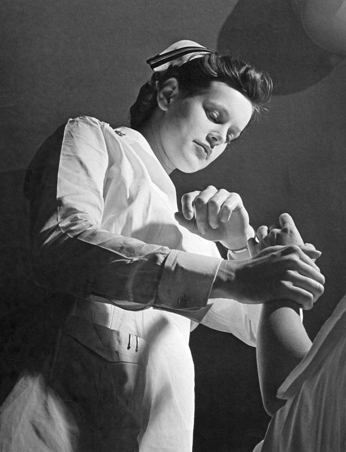 Us Navy Nurse Taking A Pulse Photograph by Underwood Archives
