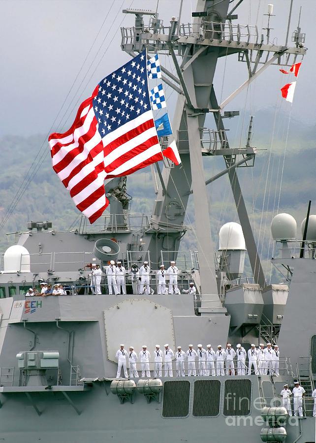 Vertical Photograph - U.s. Navy Sailors Line The Rails Aboard by Stocktrek Images