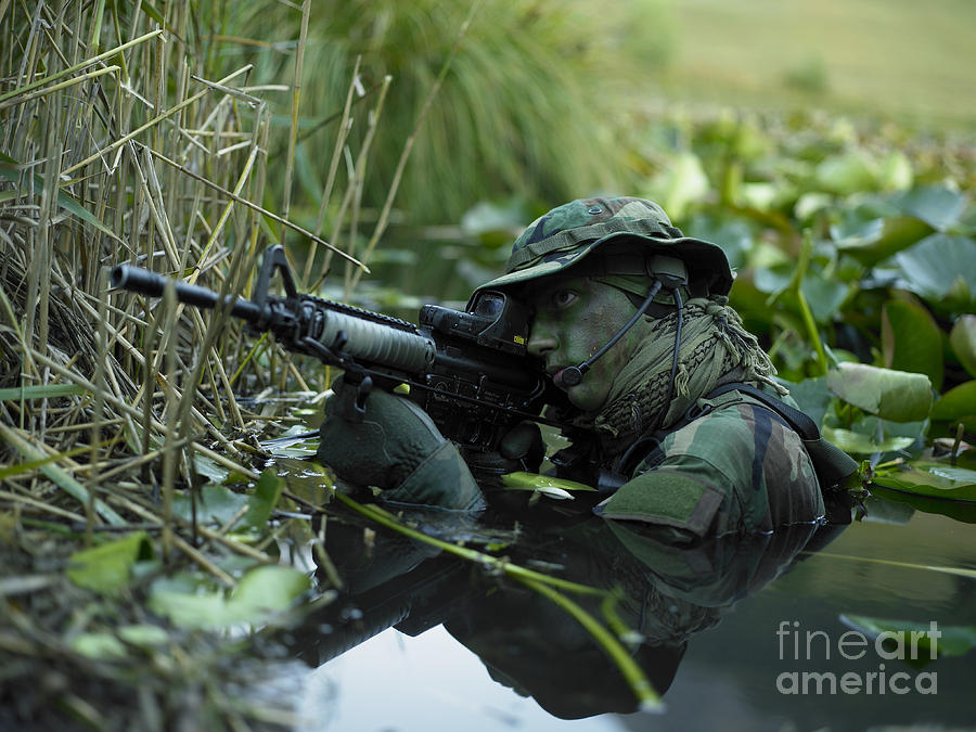 Special Operations Forces Photograph - U.s. Navy Seal Crosses Through A Stream by Tom Weber