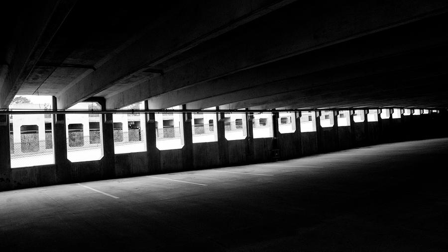 Black Photograph - Vacant Parking Garage by Ahmed Hashim