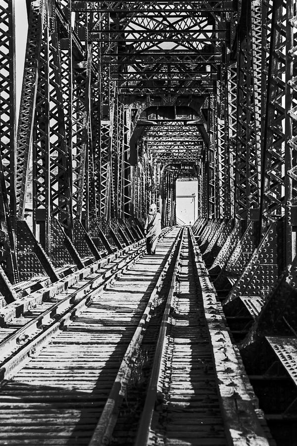 Bridge Photograph - Vagrant On Bridge by Don Wolf