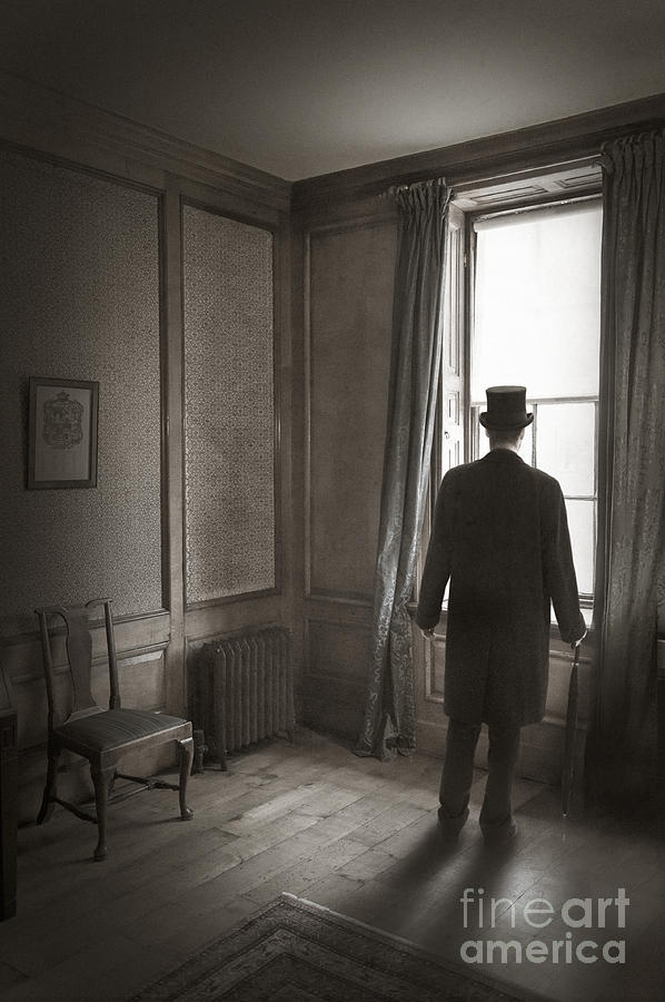 Victorian Or Edwardian Man With Top Hat Looking Out Of A