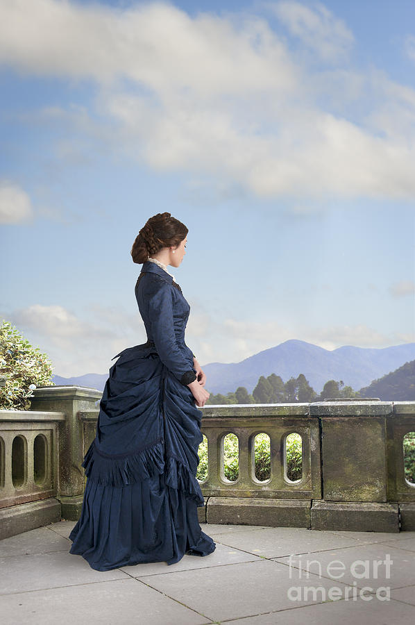 Victorian Photograph - Victorian Woman In A Blue Dress Standing On The Terrace  by Lee Avison