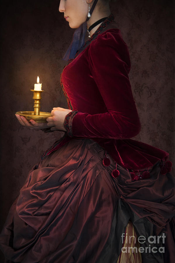 Victorian Woman In A Red Bussle Dress Holding A Candle At