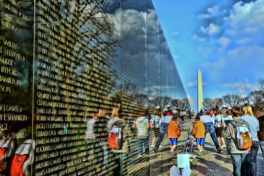 America Photograph - Vietnam Veterans Memorial And Washington Monument by Allen Beatty