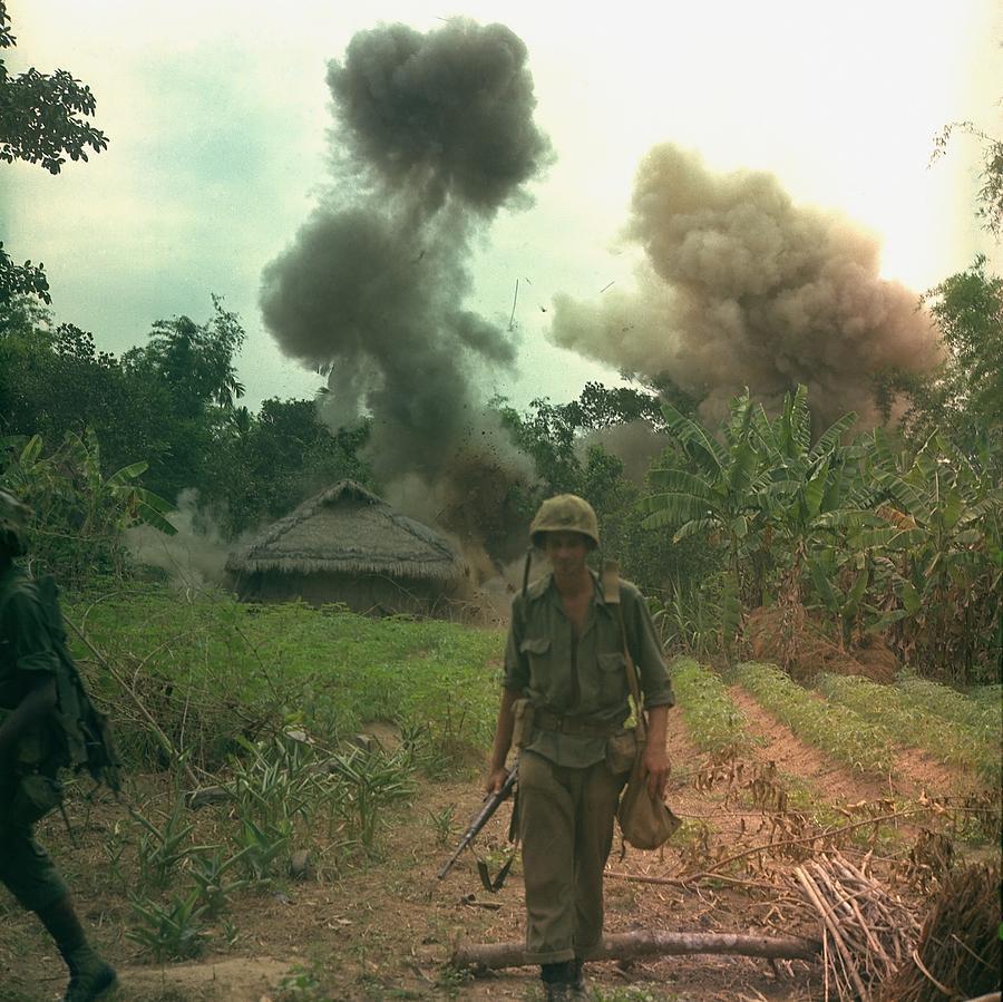 History Photograph - Vietnam War. Us Marines Walk Away by Everett