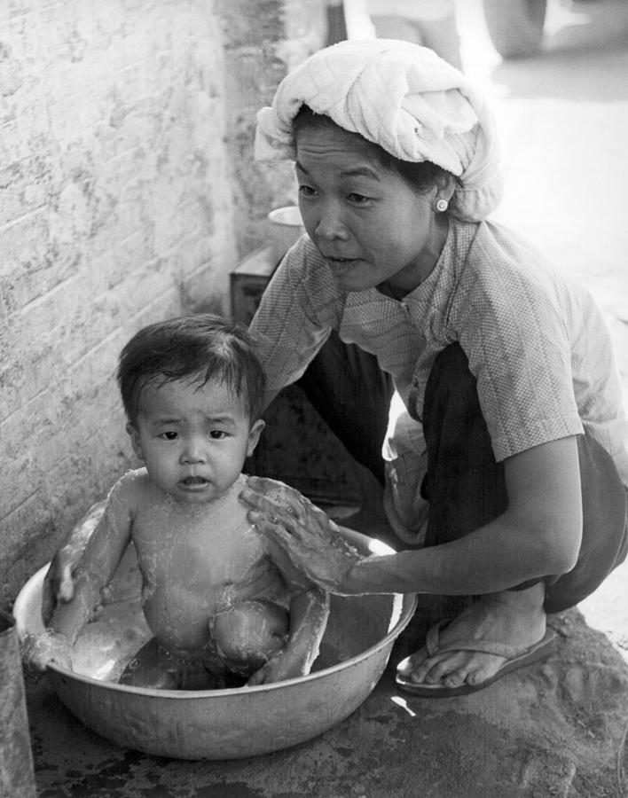 1960s Photograph - Vietnamese Orphan Bathing by Underwood Archives