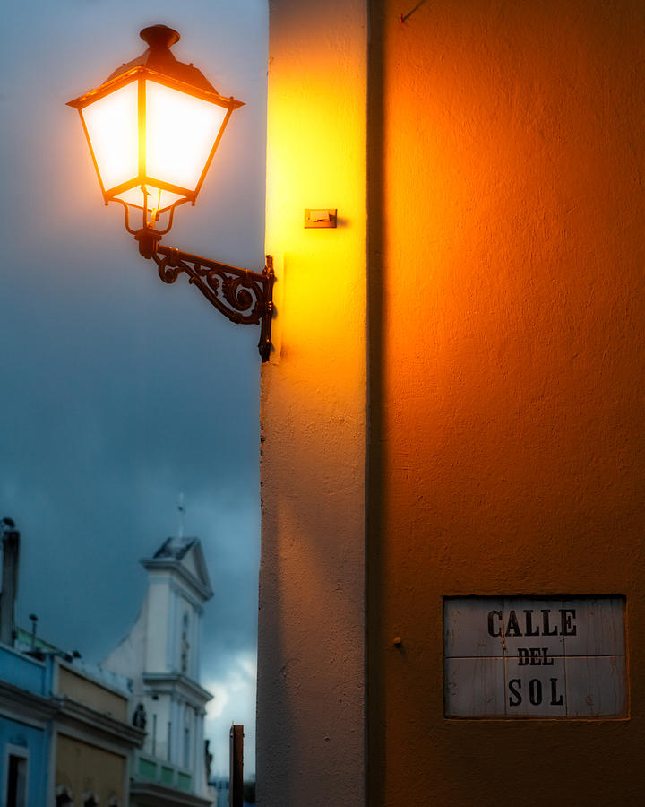 Architecture Photograph - View Of A Lit Old Street Lamp Calle Del Sol Puerto Rico by George Oze