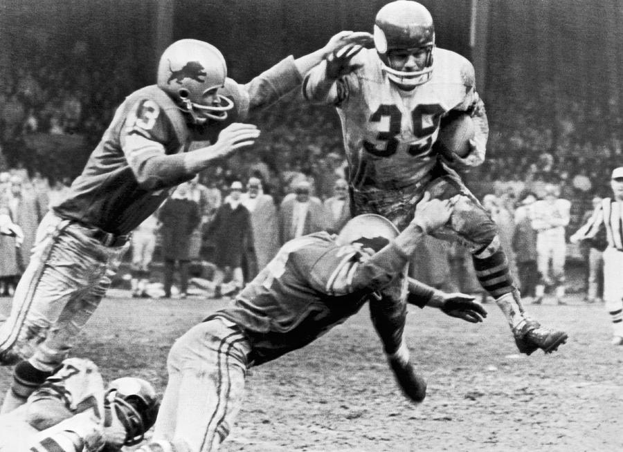 1950s Photograph - Viking McElhanny Gets Tackled by Underwood Archives