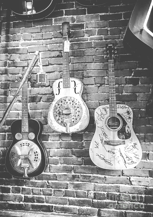 Vintage Guitar Trio In Black And White Photograph