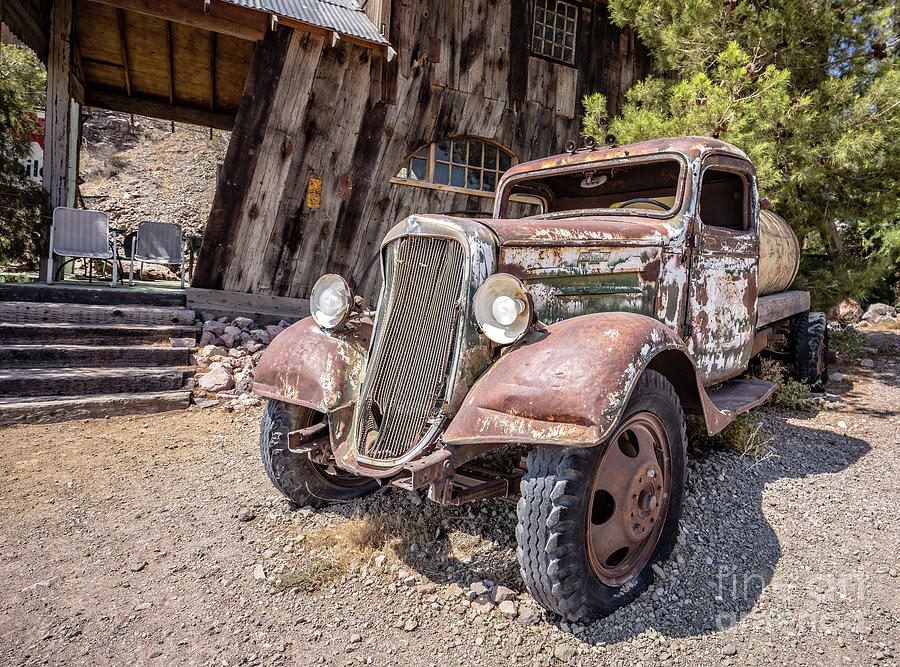 Americana Photograph - Vintage Water Truck In The Desert by Edward Fielding