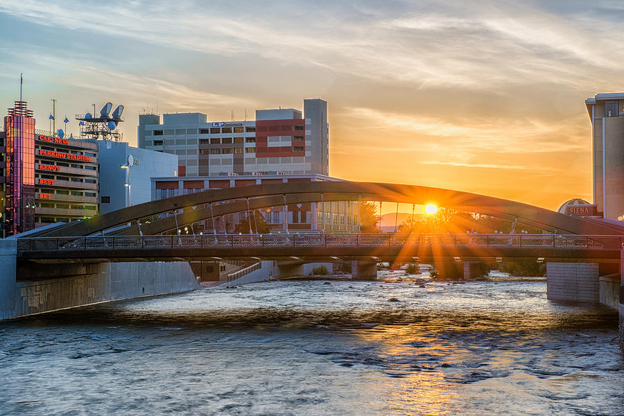 Virginia Street Bridge With Spring Sunrise Shining Through Over Truckee River With Reflection Photograph